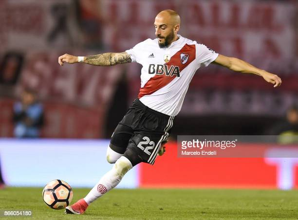 Javier Pinola of River Plate kicks the ball during a first leg match between River Plate and Lanus as part of semifinals of Copa CONMEBOL...
