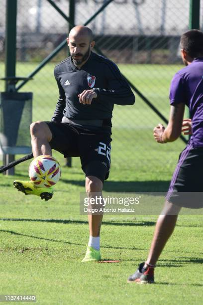 Javier Pinola of River Plate kicks the ball during a training session at River Camp Ezeiza on March 21 2019 in Buenos Aires Argentina