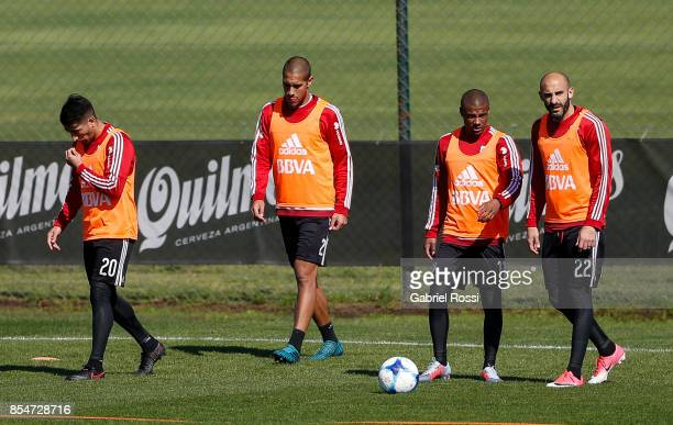 Javier Pinola of River Plate talks with teammate Nicolas De la Cruz during a training session at River Plate's training camp on September 27 2017 in...