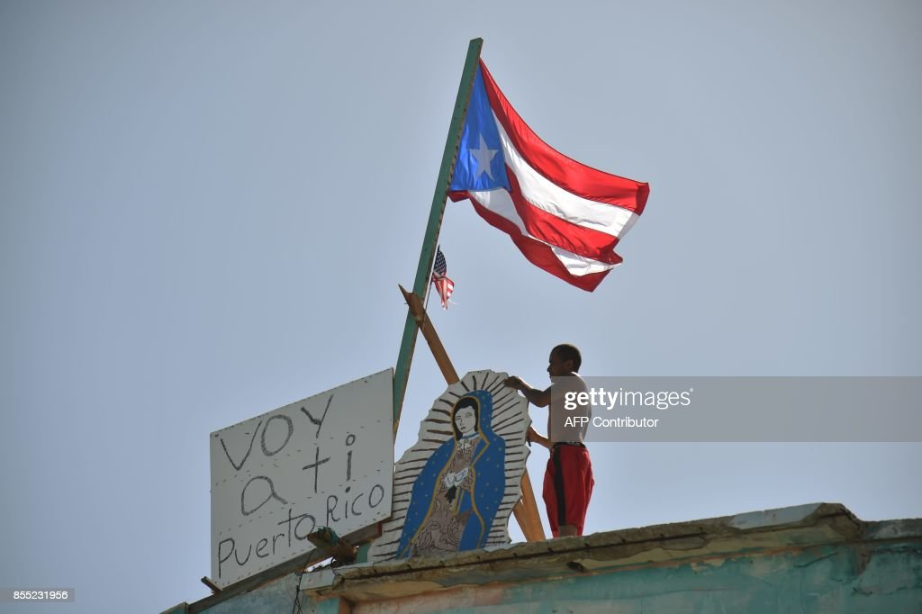 Javier places on his house next to a flag of Puerto Rico, a