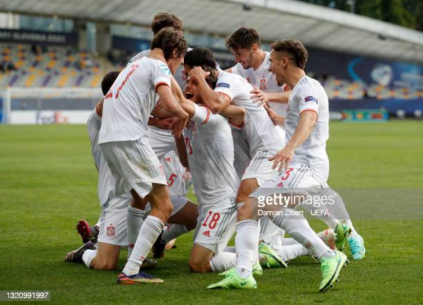 Javier Puado of Spain celebrates with team mates after scoring their side's first goal during the 2021 UEFA European Under-21 Championship...