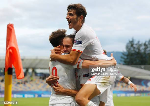 Javier Puado of Spain celebrates with team mates after scoring their side's second goal during the 2021 UEFA European Under-21 Championship...
