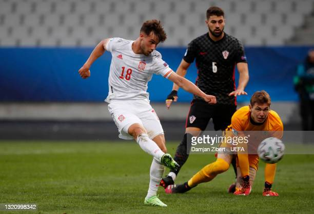 Javier Puado of Spain scores their side's second goal as Adrian Semper of Croatia looks on during the 2021 UEFA European Under-21 Championship...