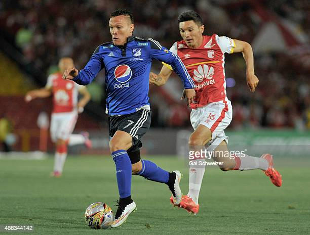 Javier Reina of Millonarios struggles for the ball with Daniel Torres of Santa Fe during a match between Millonarios and Santa Fe as part of 10th...
