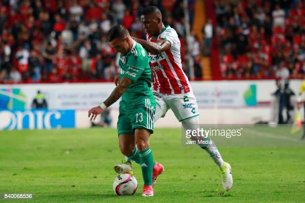 Javier Salas of Atlas and Brayan Beckeles of Nexaca fight for the ball during the seventh round match between Necaxa and Atlas as part of the Torneo...