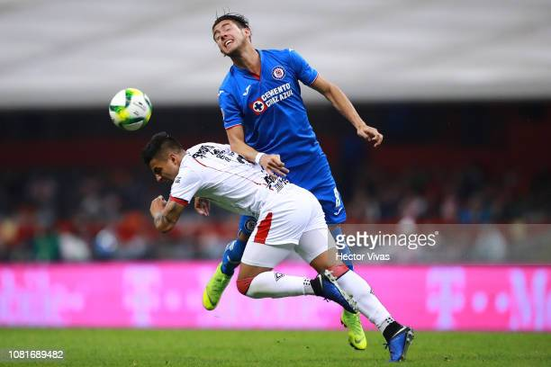 Javier Salas of Cruz Azul heads the ball against Alexis Vega of Chivas during the 2nd round match between Cruz Azul and Chivas as part of the Torneo...
