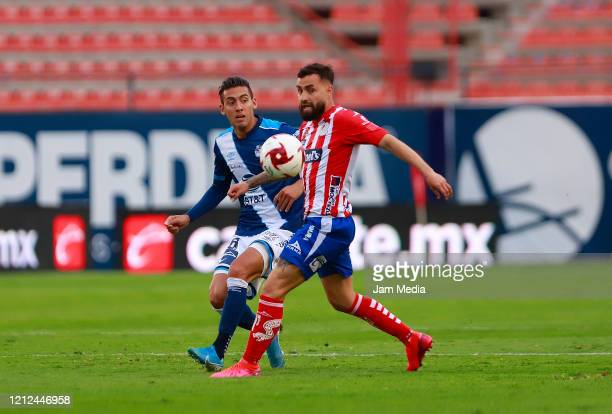 Javier Salas of Puebla fights for the ball with Felipe Gallegos of San Luis during the 10th round match between Atletico San Luis and Puebla as part...