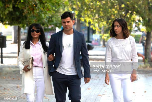 Javier Sanchez Santos, who claims to be the son of Spanish crooner Julio Iglesias, arrives with his mother Maria Edite Santos and his Italian partner...