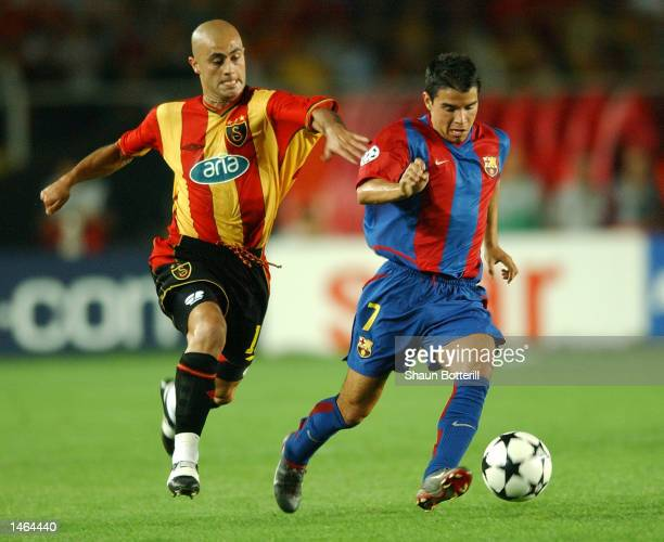 Javier Saviola of Barcelona takes on Hasan Sas of Galatasaray during the UEFA Champions League First Phase Group H match between Galatasaray and...