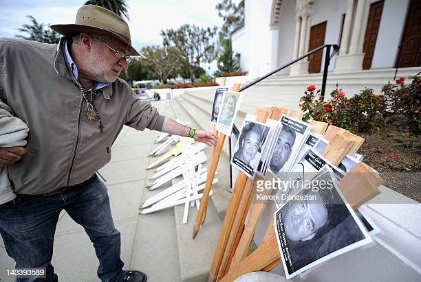 Javier Sicilia poet and leader of the Mexican antidrug group Movement for Peace with Justice and Dignity picks up a poster to lead a 50cross...
