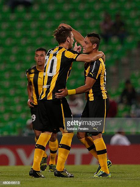 Javier Toledo of Penarol celebrates with his teammates after scoring the opening goal during a match between Santos Laguna and Penarol as part of the...
