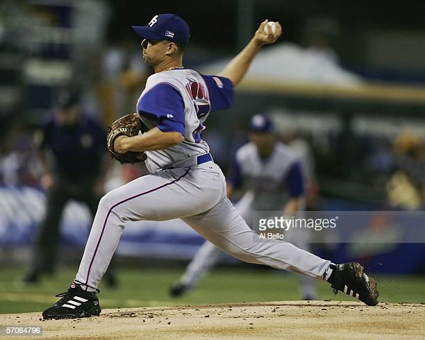 Javier Vazquez of Puerto Rico pitches against the Dominican Republic during their game in the second round of the World Baseball Classic at Hiram...