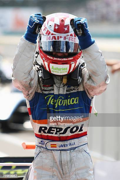 Javier Villa of Spain celebrates his first place in the 2007 GP2 Series prior to the Hungarian Formula One Grand Prix at the Hungaroring on August 5...