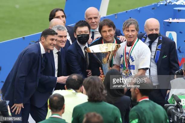 Javier Zanetti , Alessandro Antonelli , Steven Zhang , Antonio Conte , Gabriele Oriali and Giuseppe Marotta pose with the Scudetto trophy following...