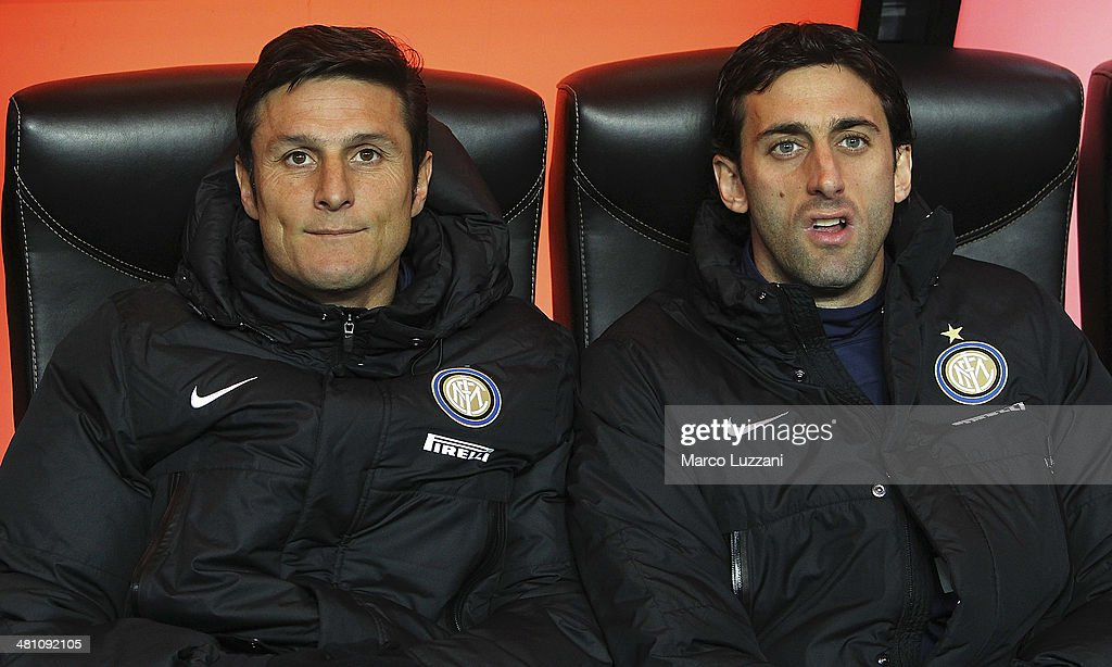 Javier Zanetti and Diego Alberto Milito of FC Internazionale Milano look on before the Serie A match between FC Internazionale Milano and Udinese Calcio at San Siro Stadium on March 27, 2014 in Milan, Italy.