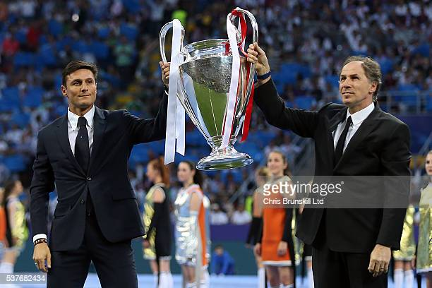 Javier Zanetti and Franco Baresi parade the trophy ahead of the UEFA Champions League Final between Real Madrid and Club Atletico de Madrid at Stadio...