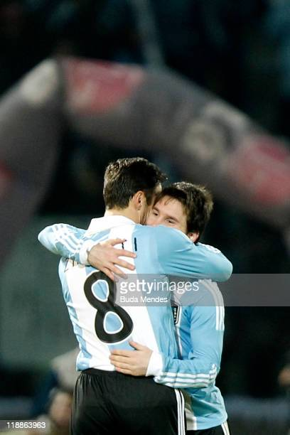 Javier Zanetti and Lionel Messi of Argentina celebrate scored goal during a match as part of Group A of Copa America 2011 at the Mario Kempes Stadium...