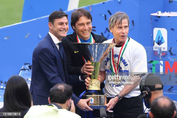 Javier Zanetti , Antonio Conte and Gabriele Oriali pose with the Scudetto trophy following the Serie A match between FC Internazionale Milano and...