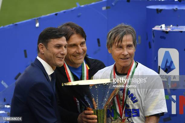 Javier Zanetti , deputy president of FC Internazionale, Antonio Conte, head coach, and Gabriele Oriole, first team technical manager, hold the...