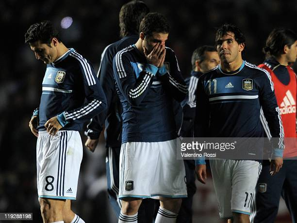 July 16: Javier Zanetti, Gonzalo Higuain and Carlos Tevez, of Argentina, reacts after missing the penalty series against Uruguay during 2011 Copa...