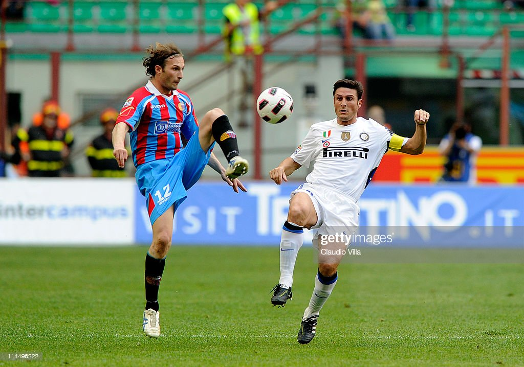 Javier Zanetti of FC Inter Milan and Giovanni Marchese of Catania Calcio compete for the ball during the Serie A match between FC Internazionale Milano and Catania Calcio at Stadio Giuseppe Meazza on May 22, 2011 in Milan, Italy.