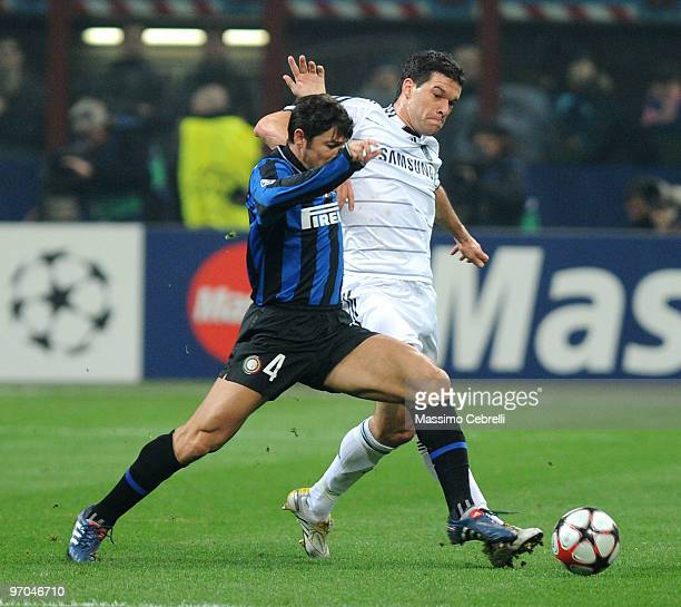 Javier Zanetti of FC Inter Milan battles for the ball against Michael Ballack of Chelsea during the UEFA Champions League round of 16 first leg match...