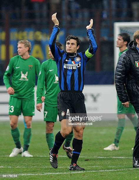 Javier Zanetti of FC Inter Milan celebrates the victory cheering his supporters after the UEFA Champions League Group F match between FC Inter Milan...