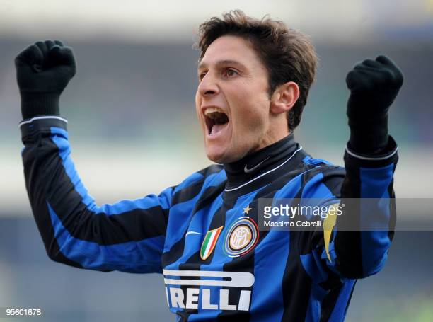 Javier zanetti of FC Inter Milan celebrates the victory cheering his fans after the Serie A match between AC Chievo Verona and FC Inter Milan at...