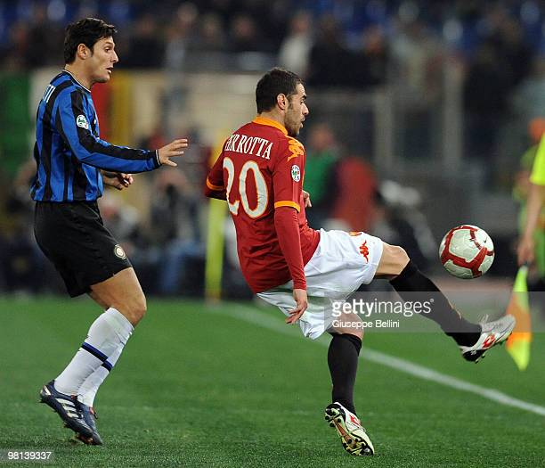 Javier Zanetti of Inter and Simone Perrotta of Roma in action during the Serie A match between AS Roma and FC Internazionale Milano at Stadio...