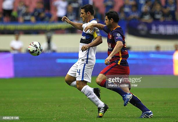 Javier Zanetti of Inter Forever is challenged by Albert Luque Martos of Barcelona during the The 2015 Winning League International Legends...