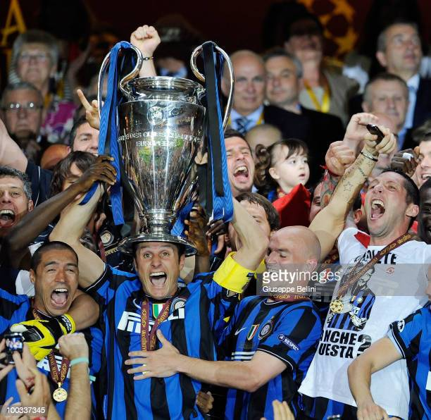 Javier Zanetti of Inter Milan lifts the UEFA Champions League trophy after defeating FC Bayern Muenchen at the UEFA Champions League Final match at...