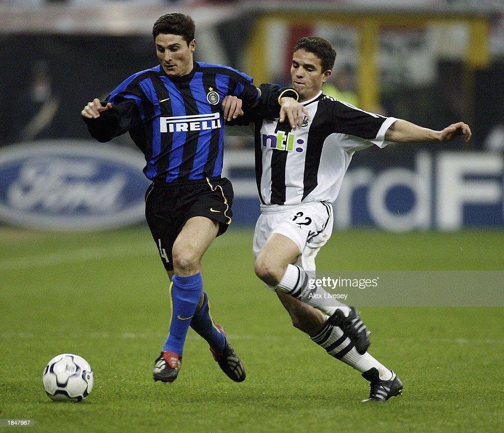 Javier Zanetti of Inter Milan and Laurent Robert of Newcastle United : News Photo