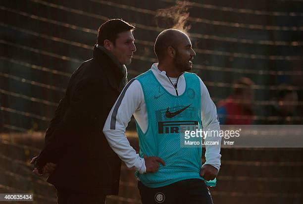 Javier Zanetti speaks to Cicero Moreira Jonathan of FC Internazionale Milano looks on during FC Internazionale training session at the club's...