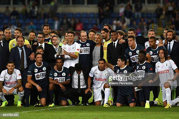 Javier Zanetti with the trophy at the end of the Interreligious Match For Peace at Olimpico Stadium on September 1 2014 in Rome Italy