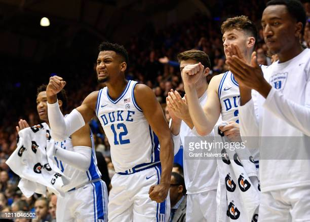 Javin DeLaurier andf the Duke Blue Devils bench react during the first half of their game against the North Carolina Tar Heels at Cameron Indoor...