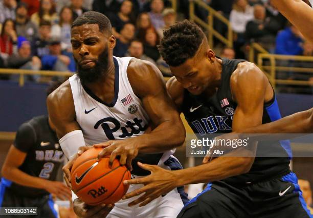 Javin DeLaurier of the Duke Blue Devils and Jared WilsonFrame of the Pittsburgh Panthers battle for a rebound at Petersen Events Center on January 22...