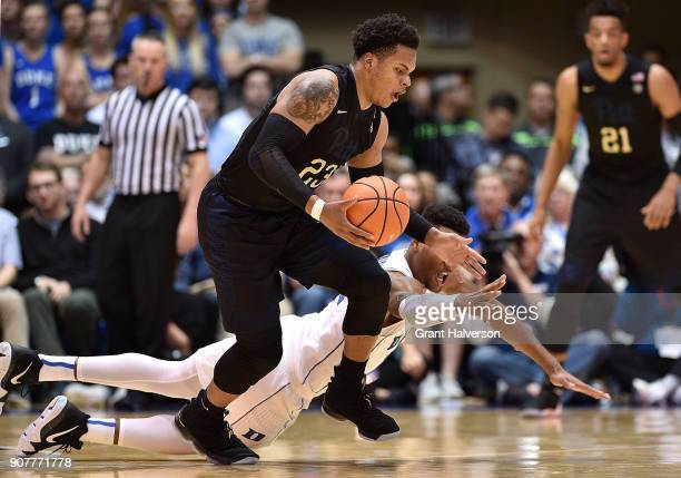 Javin DeLaurier of the Duke Blue Devils battles Shamiel Stevenson of the Pittsburgh Panthers for a loose ball during their game at Cameron Indoor...