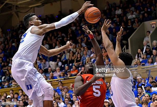 Javin DeLaurier of the Duke Blue Devils blocks a shot by Khallid Hart of the Marist Red Foxes during the game at Cameron Indoor Stadium on November...