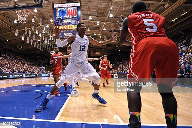 Javin DeLaurier of the Duke Blue Devils defends against Khallid Hart of the Marist Red Foxes during their game at Cameron Indoor Stadium on November...