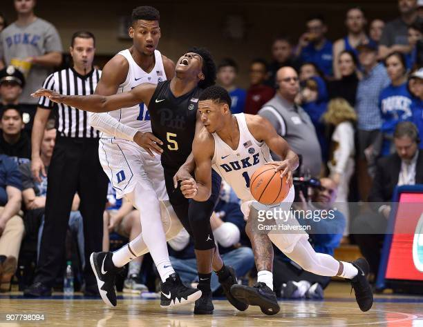 Javin DeLaurier of the Duke Blue Devils fouls Marcus Carr of the Pittsburgh Panthers as he sets a pick for teamate Trevon Duval during their game at...