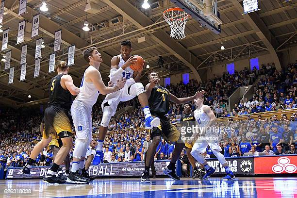 Javin DeLaurier of the Duke Blue Devils rebounds against the Appalachian State Mountaineers during the game at Cameron Indoor Stadium on November 26...