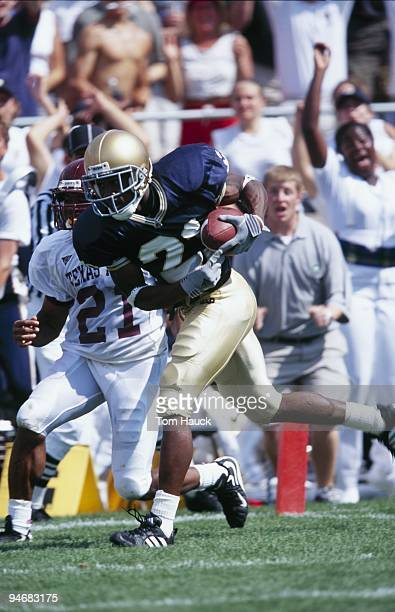 Javin Hunter of the Notre Dame Fighting Irish carries the ball during the game against the Texas AM Aggies at Notre Dame Stadium on September 2 2000...