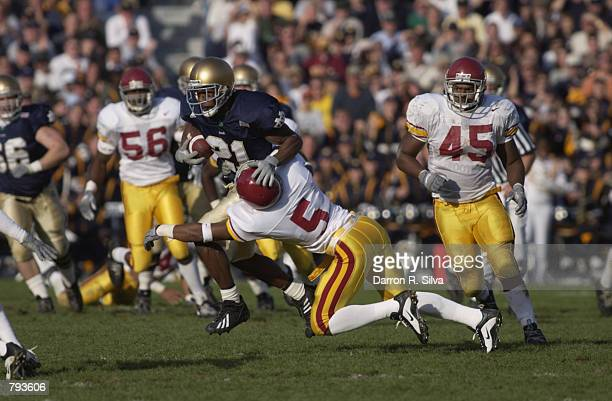 Javin Hunter of the Notre Dame University Fighting Irish fights off DeShaun Hill of USC Trojans during the game on October 202001 at Notre Dame...