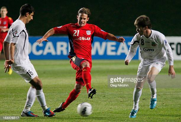Javlon Ibrokhimov and Artyom Filiposyan of Bunyodkor and Carlos Neumann of Adelaide fight for the ball during the AFC Champions League Quarter Final...