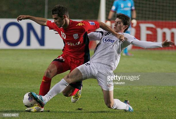 Javlon Ibrokhimov of Bunyodkor and Dario Vidosic of Adelaide fight for the ball during the AFC Champions League Quarter Final match between FC...