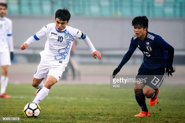 Javokhir Sidikov of Uzbekistan drives the ball during the AFC U23 Championship quarterfinal match between Japan and Uzbekistan at Jiangyin Stadium on...