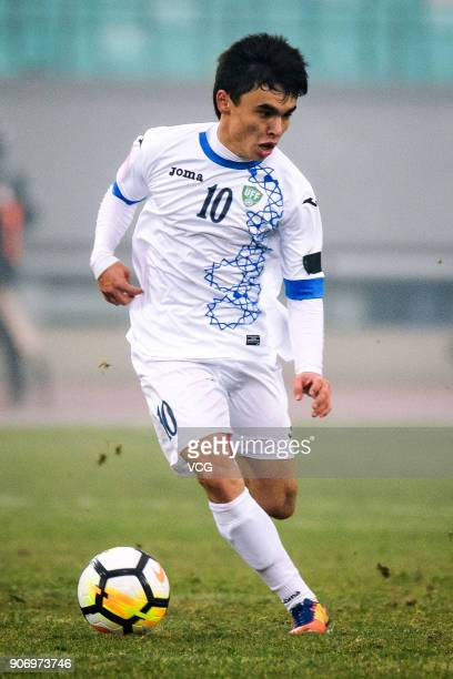 Javokhir Sidikov of Uzbekistan drives the ball during the AFC U23 Championship quarterfinal match between Japan and Uzbekistan at Jiangyin Stadium on...