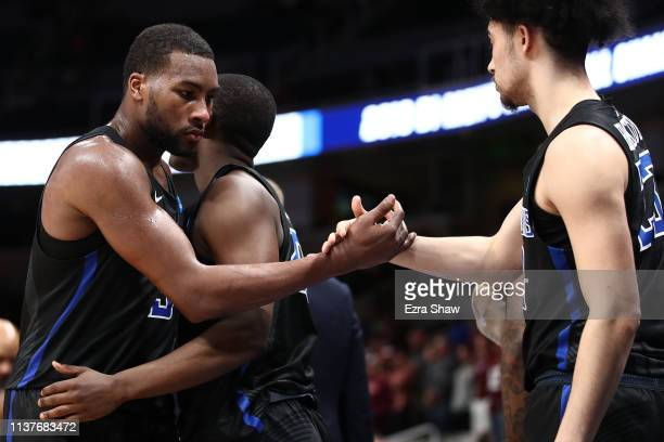 Javon Bess and Elliott Welmer of the Saint Louis Billikens reacts in the final moments of their 6652 loss to the Virginia Tech Hokies during their...