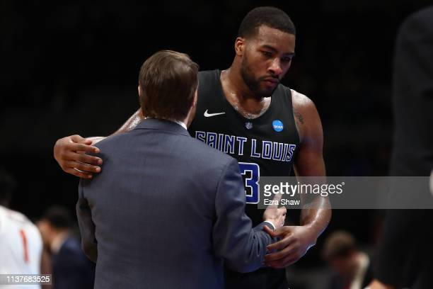Javon Bess and head coach Travis Ford of the Saint Louis Billikens react in the final moments of their 6652 loss to the Virginia Tech Hokies during...