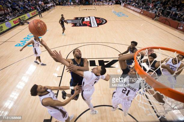Javon Bess of the Saint Louis Billikens goes up for a shot against Dominick Welch of the St Bonaventure Bonnies during the championship game of the...